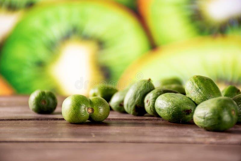 Fresh green mini baby kiwi fruit with sliced kiwi royalty free stock photo