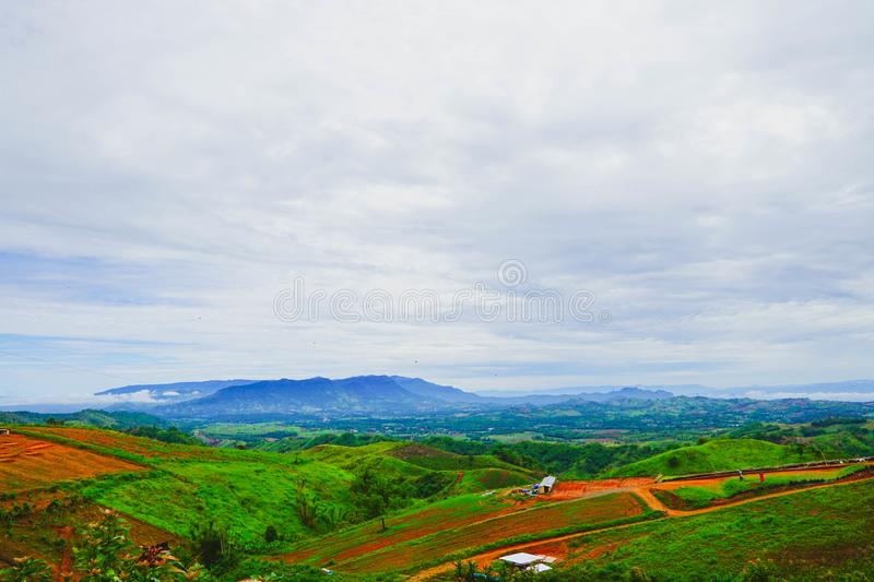Fresh green mountainand and cloudy sky in morning, at Khao Kho, Phetchabun, Thailand.  stock photos