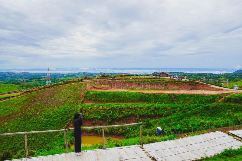 Fresh green mountainand and cloudy sky in morning, at Khao Kho, Phetchabun, Thailand.  royalty free stock photo