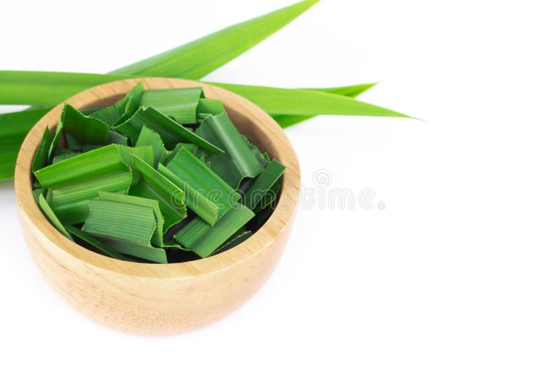 Fresh green pandan leaves with slice in wood bowl isolated on white background. Fresh green pandan leaves with slice in wood bowl isolated royalty free stock photo