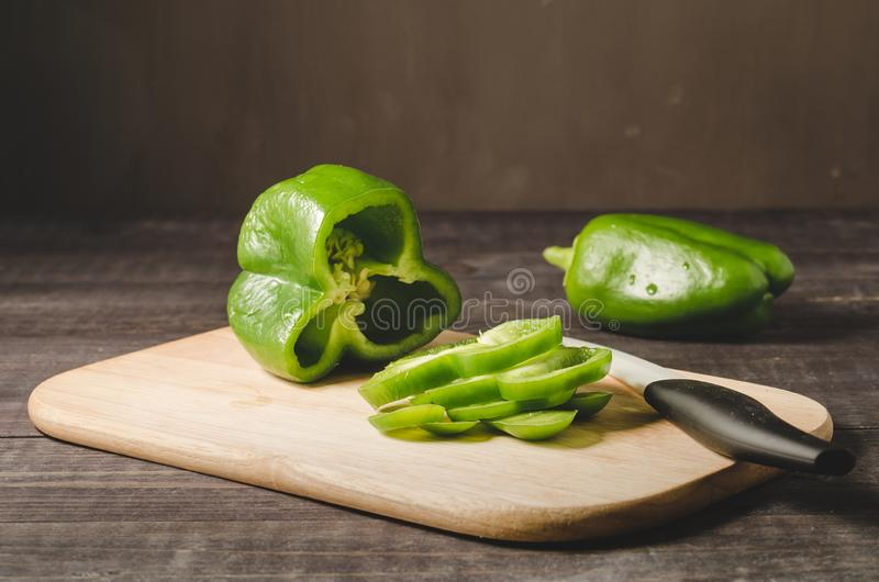 freshwater green paprika cut on a wooden board/fresh green paprika cut on a wooden board, selective focus royalty free stock photos
