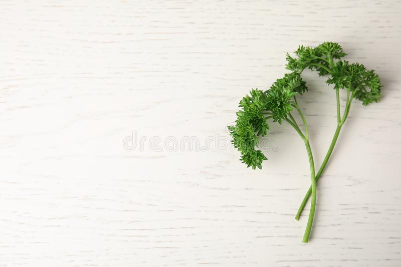 Fresh green parsley on white wooden table. Space for text. Fresh green parsley on white wooden table, flat lay. Space for text stock photos