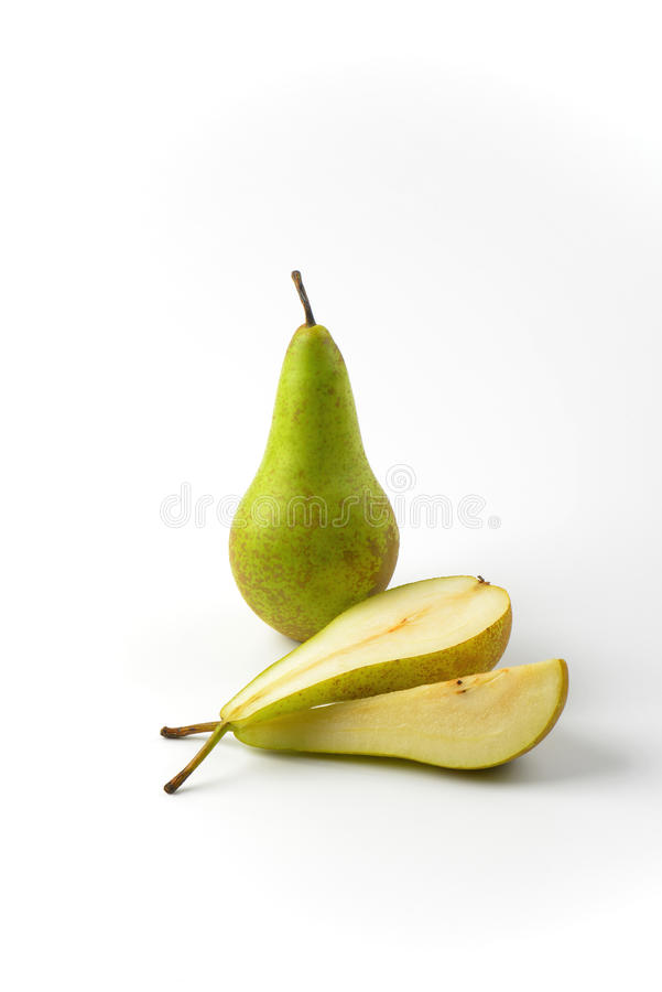 Fresh green pears. One whole pear, one half a pear and slice royalty free stock image