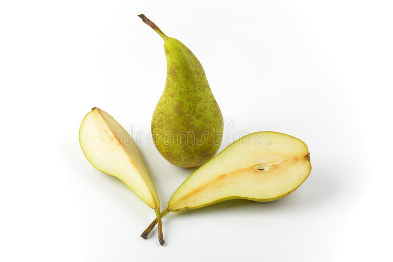 Fresh green pears. One whole pear, one half a pear and slice royalty free stock photography