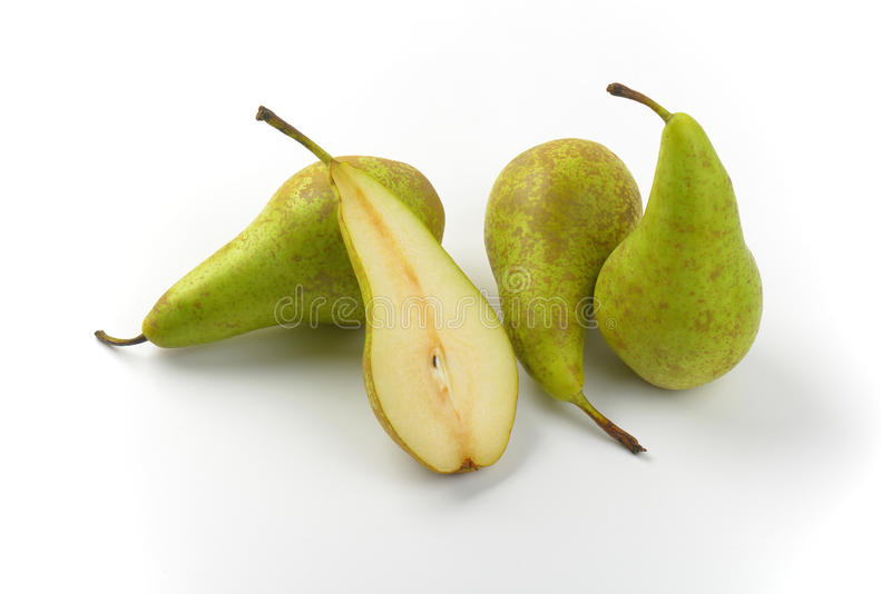 Fresh green pears. Three whole pears and half a pear royalty free stock images