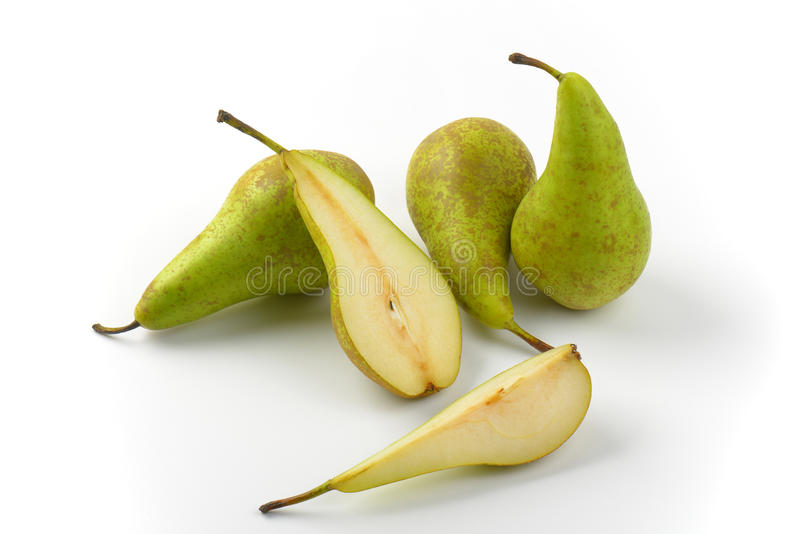Fresh green pears. Three whole pears, half a pear and slice stock images