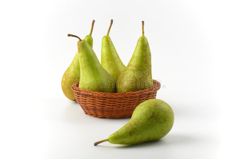 Fresh green pears. In wicker bowl royalty free stock image