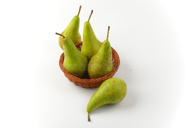 Fresh green pears. In wicker bowl stock photo