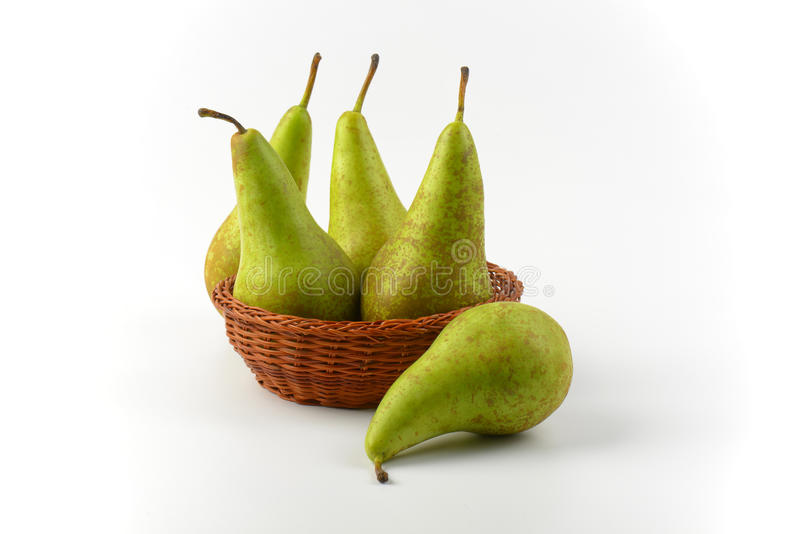 Fresh green pears. In wicker bowl royalty free stock photos