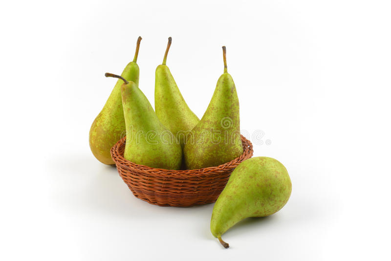 Fresh green pears. In wicker bowl stock images