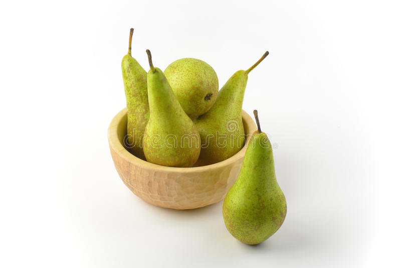 Fresh green pears. In wooden bowl royalty free stock photography