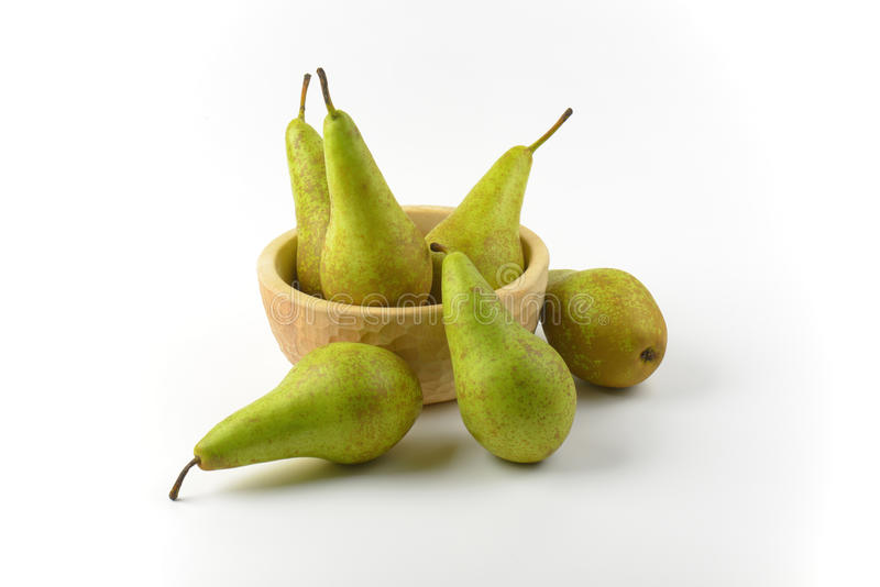 Fresh green pears. In wooden bowl royalty free stock images