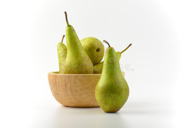 Fresh green pears. In wooden bowl stock images