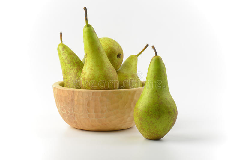 Fresh green pears. In wooden bowl stock photography