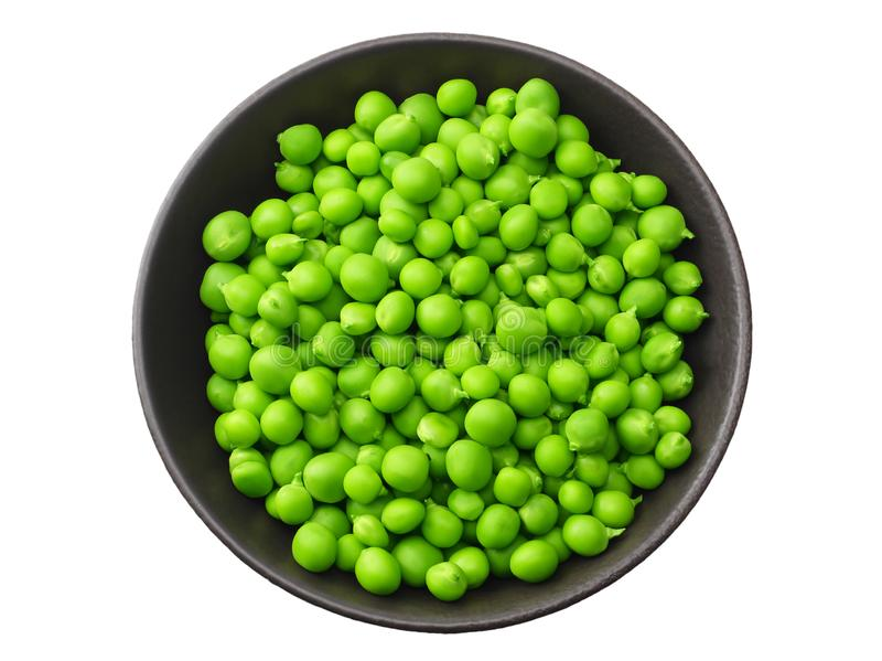 fresh green peas in a black plate isolated on white background. top view royalty free stock images