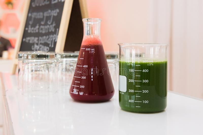 Fresh green and red organic gluten-free juice on bar counter on event party. stock photography
