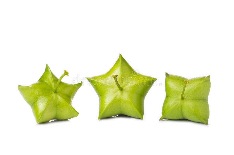 Fresh green Sacha Inchi fruits on white background. With copy space royalty free stock images