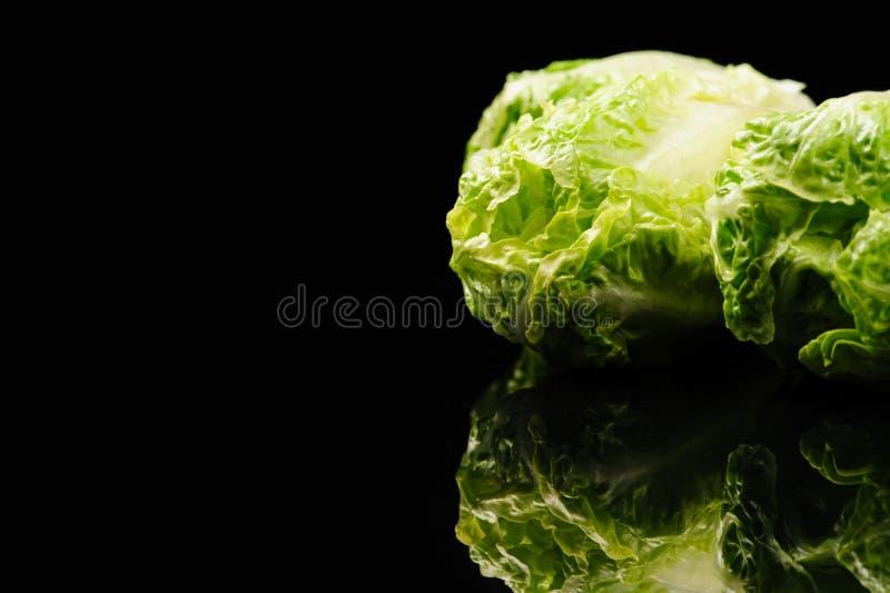 Fresh green salad. On the black background, organic, ingredient, vegetable, lettuce, food, vitamin, healthy, leaf, vegetarian, freshness, raw, nutrition stock photo