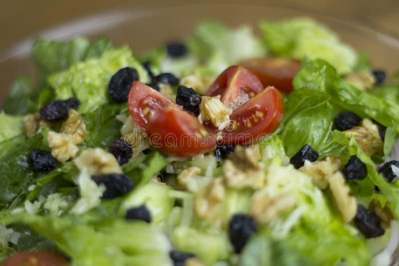 Fresh green Salad recipe ingredient black olives garlic fork on wooden table royalty free stock image