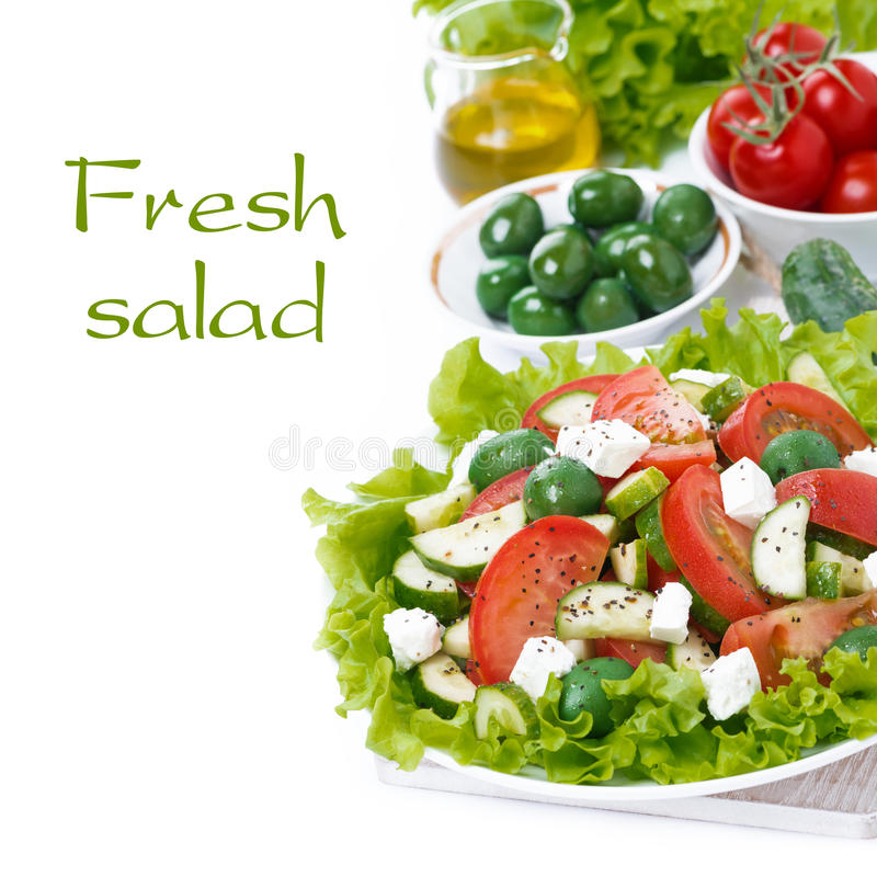 Fresh green salad with vegetables and feta and ingredients. Isolated on white royalty free stock photos