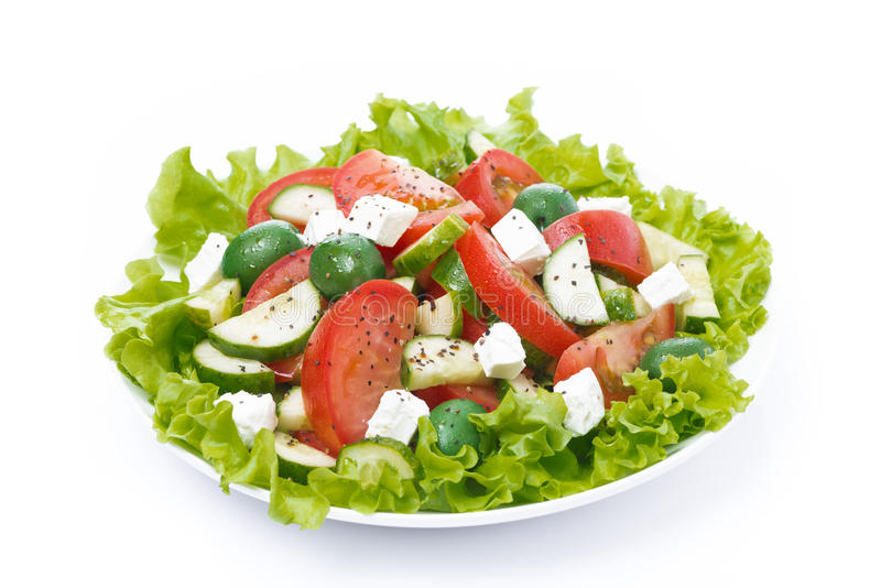 Fresh green salad with vegetables and feta, isolated royalty free stock images