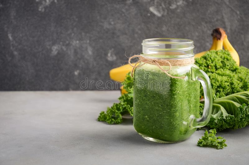 Fresh green smoothie with kale and banana. Fresh green smoothie with kale and banana, selective focus, copy space royalty free stock image