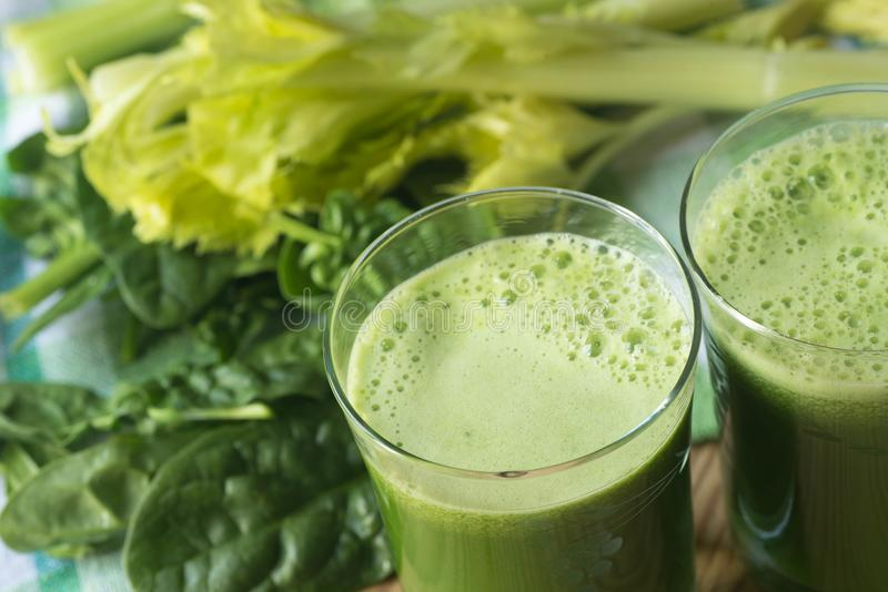 Fresh green spinach leaves and celery juice royalty free stock image