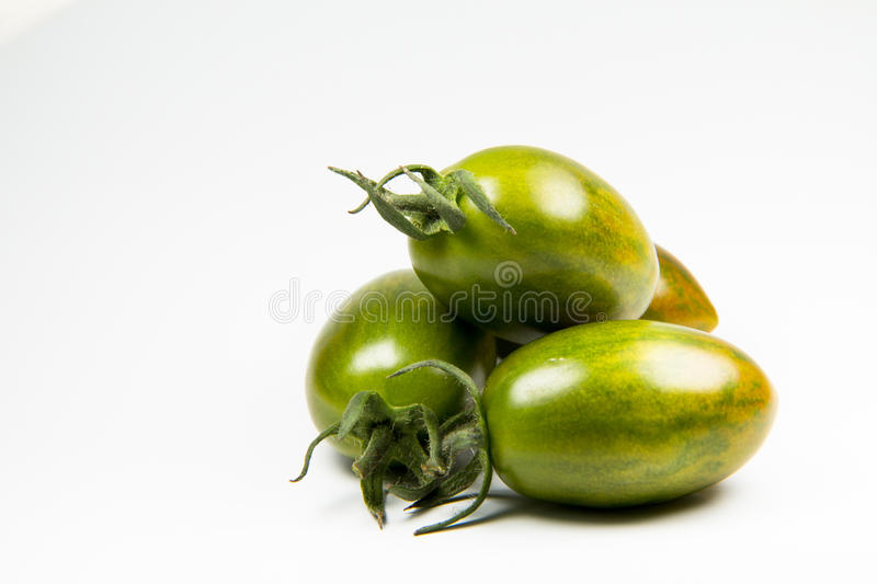 Fresh green tiger tomatoes on white background stock image