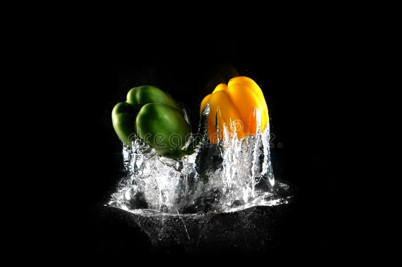 Fresh Green, Yellow Bell Peppers with Water Splash and Bubble Isolated. Group of Paprika of Healthy Copy Space. Colored Paprika royalty free stock photo