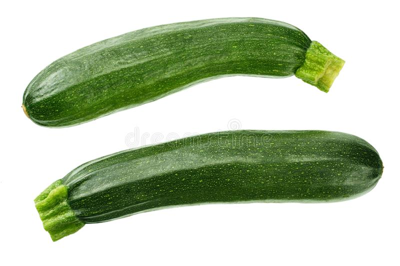 fresh green zucchini with slice isolated on white background. top view stock photography