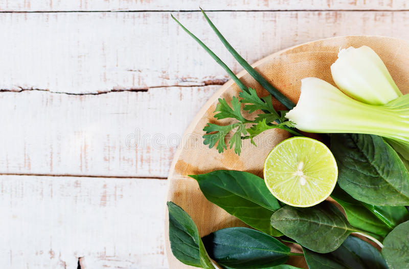 Fresh greenery on cutting board stock image