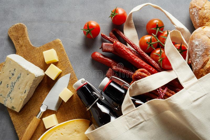Fresh groceries, cheeseboard and craft beer royalty free stock images