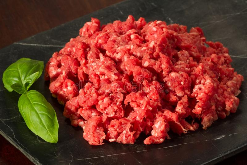 Fresh Ground Beef with Garnish on Slate Close Up stock images