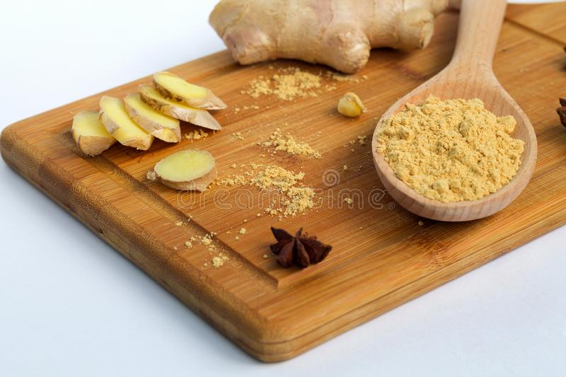 Fresh and ground ginger on a cutting board royalty free stock images