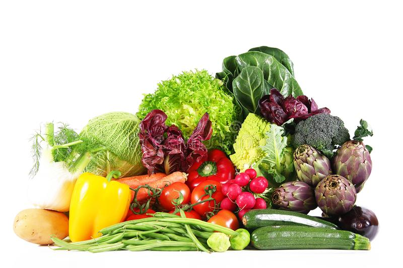 Fresh group of vegetables on white background. A fresh group of vegetables on white background royalty free stock photo