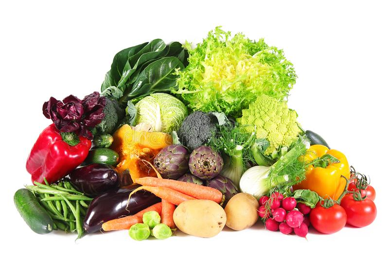 Fresh group of vegetables on white background. A fresh group of vegetables on white background royalty free stock image