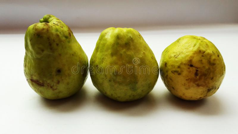 Fresh guava isolated on white background closeup image. Cabbage, marketplace, shelf, sell, tomatoes, sale, peppers, fruits, supermarket, store, department stock photo