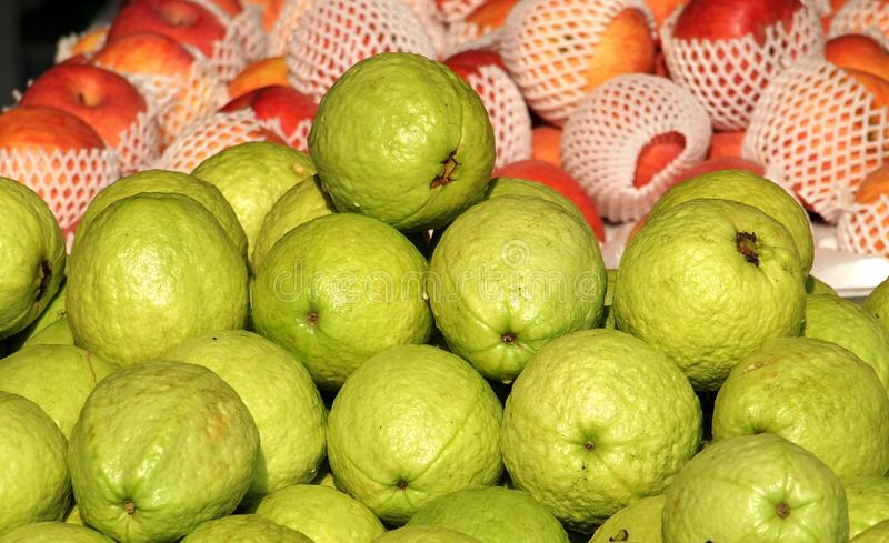 Fresh Guavas and Apples for Sale stock photos