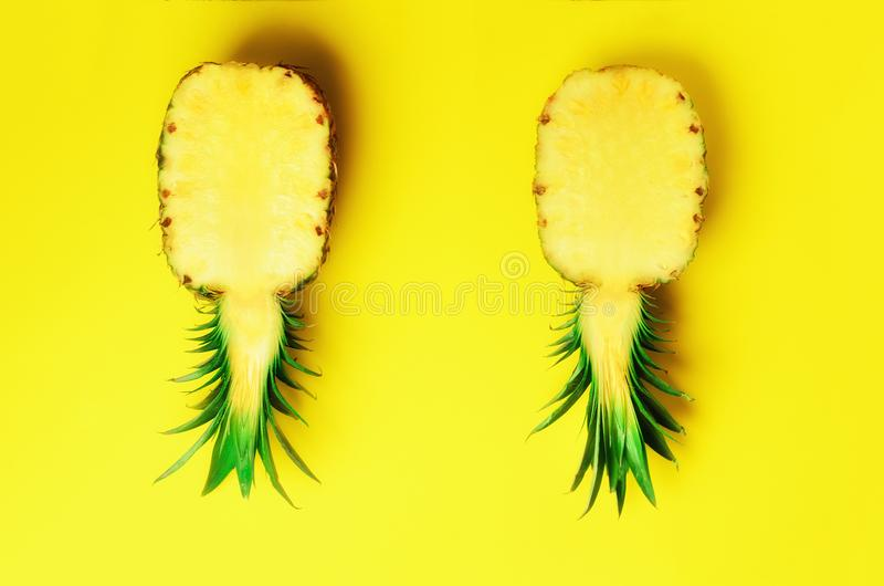 Fresh half sliced pineapple on yellow background. Top View. Copy Space. Bright pineapples pattern for minimal style. Pop. Art design, creative concept royalty free stock photography