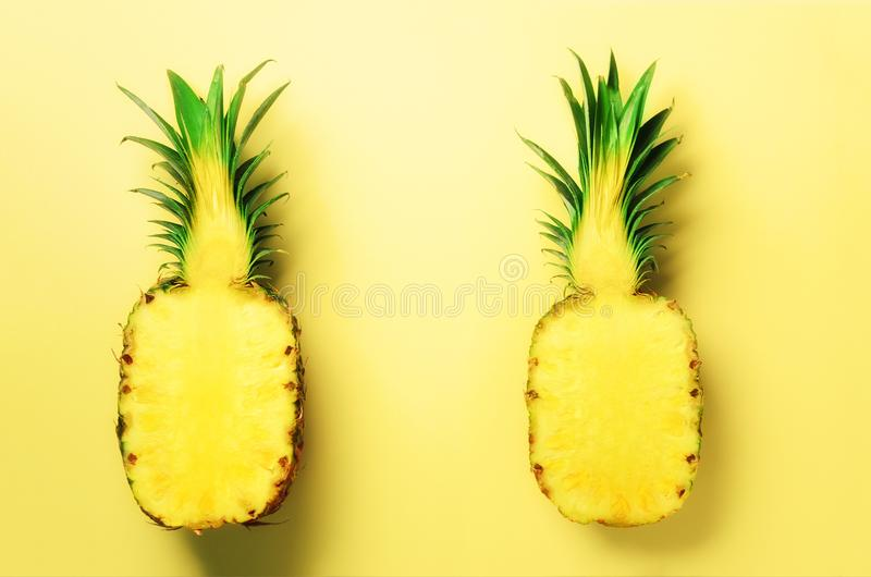 Fresh half sliced pineapple on yellow background. Top View. Copy Space. Bright pineapples pattern for minimal style. Pop royalty free stock images