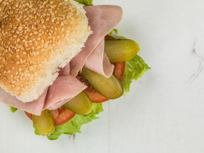 Fresh Ham Salad With Gherkins Tomato and Lettuce Sesame Seed Bread Roll or Bun Sandwich royalty free stock photography