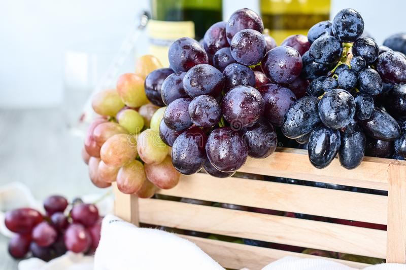 Grapes in a wooden box stock photos