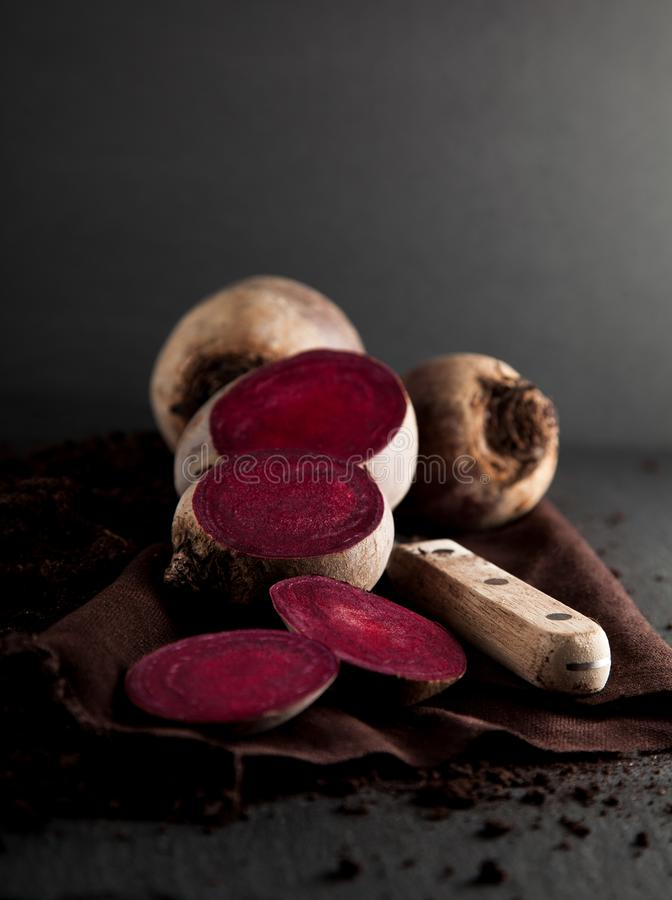 Fresh harvested beetroot on dark slate kitchen plate stock photos