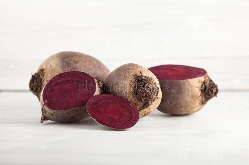 Fresh harvested beetroot on white wooden kitchen plate royalty free stock image