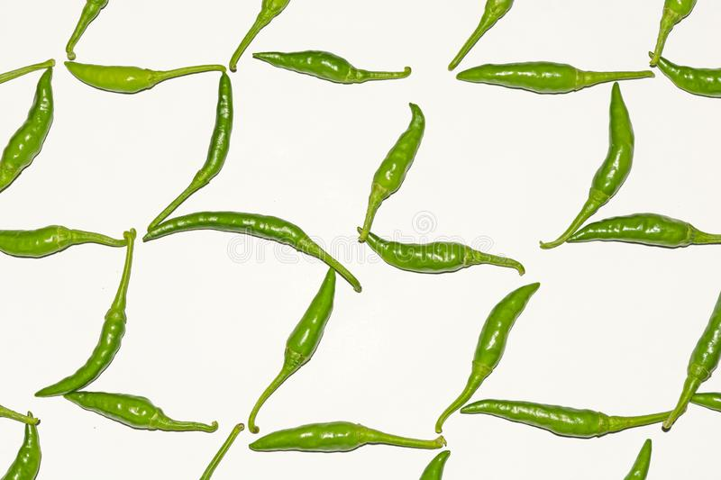 Fresh harvested green chili on white background. Fresh harvested green chili pattern on white isolated background.Flat lay.top view royalty free stock photography