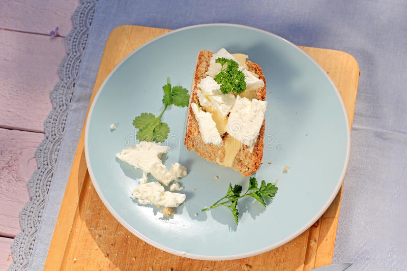 Fresh healthy breakfast, a slice of soda bread with butter and cottage cheese royalty free stock image
