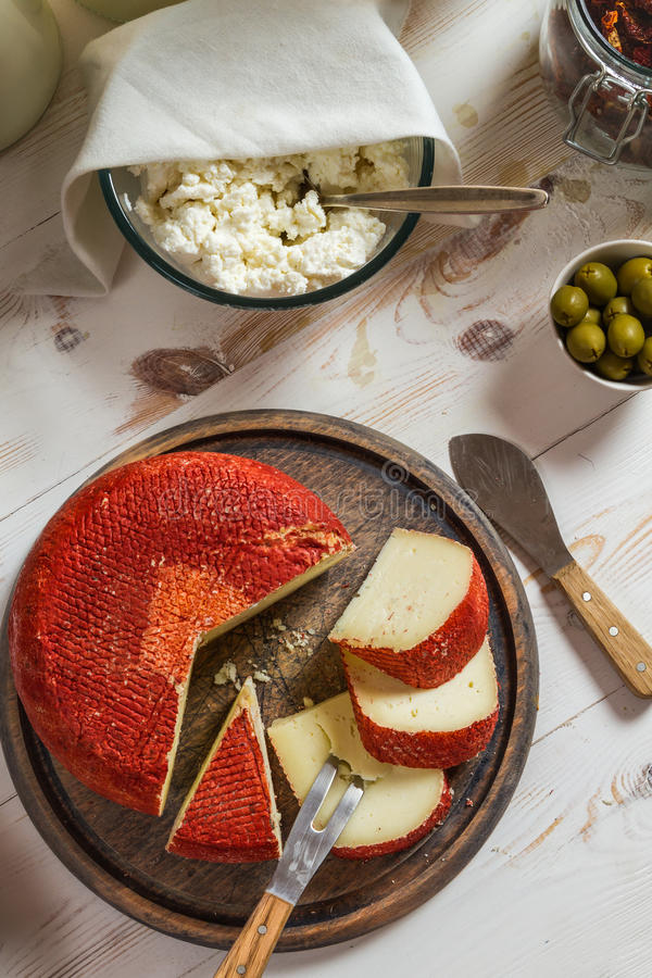 Fresh and healthy dairy products for breakfast with red wax cheese stock photo