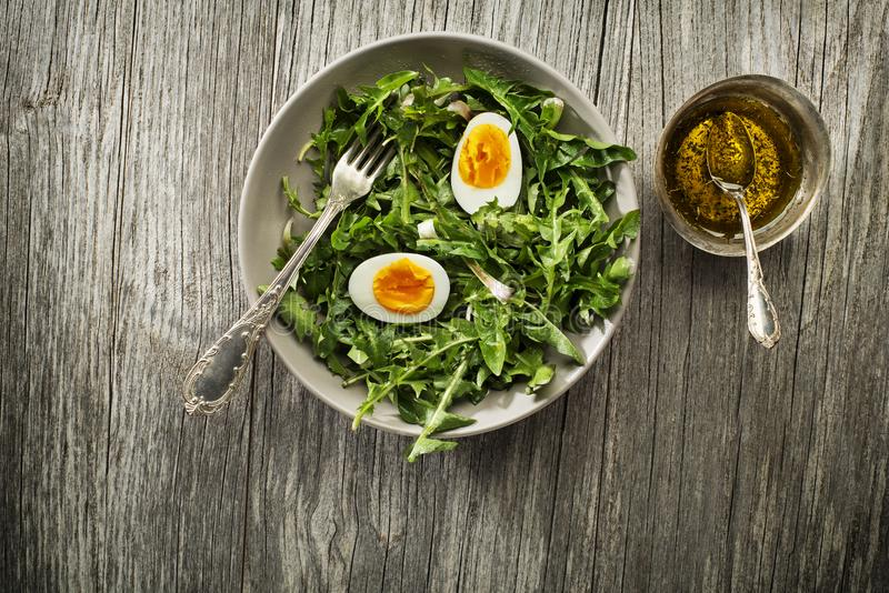 Dandelion salad with eggs royalty free stock photos
