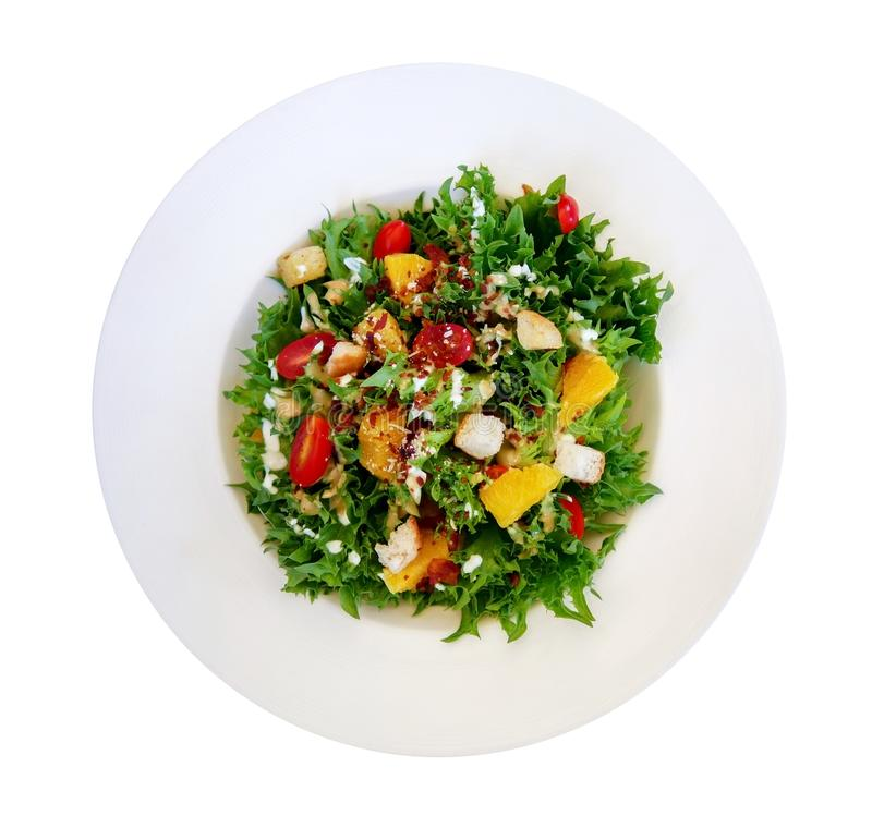 Fresh healthy green caesar salad top view solated on white backgound, path royalty free stock photography