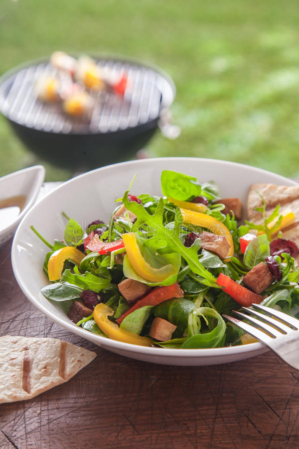 Fresh healthy herb salad on a picnic table stock image